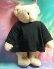 "16"" white Vermont teddy bear wearing a black Vermont teddy bear Co. lg. sl. tee."