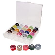 Hilo y bobinas coloridos de la máquina de coser 25x con el caso para