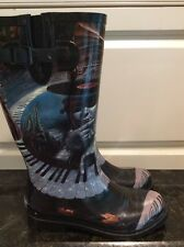 Icon Rainboots, Size 9. Spiral Piano Staircase Art.