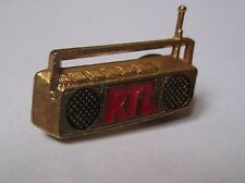 pin's RTL (double attache / signé decat)