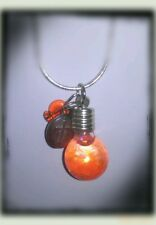 Religious glass pendant with genuine anointing oil sealed with a saint medallion