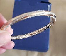 Genuine Swarovski Gold Plated Twist Bangle  in box Excellent condition 7in