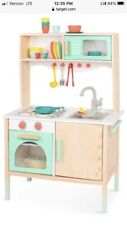 B. Toys Wooden Play Kitchen Mini Chef Kitchenette for Ages 3 *wrinkled Box*