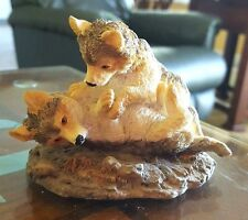 Young Inc. Wolf pups playing, resin, 1996