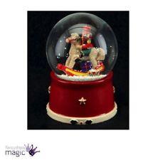Palle di neve e snow globe natalizie multicolore
