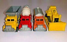 Hot Wheels 1979 Peterbilt Dump, Cement Truck, Tanker and CAT Bulldozer Lot of 4