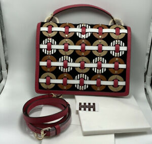Henri Bendel woven circle crossbody bag purse lipstick