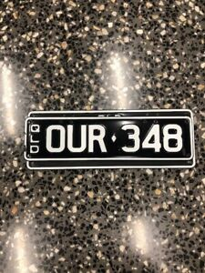 """Ferrari Personal Plate Qld Rego Black and White """"OUR 348"""""""
