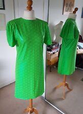 Short green psychedelic print Lycra dress. Short flared sleeves.