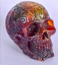 AMBER TYPE SKULL, decorated with Celtic symbols.