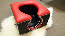 horse shoe smother toilet box red and black with locks and restraint points,