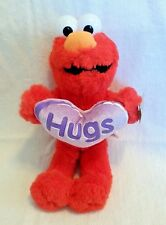 """Sesame Street Elmo plush holding purple """"Hugs"""" heart. 12 inches. With tags. 2006"""