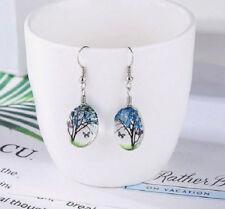 DRIED FLOWER TREE OF LIFE BUTTERFLY GLASS CABOCHON DANGLE EARRINGS. BLUE