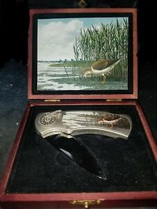 Brand new Hunting knife in case with Duck picture on knife and box....