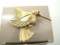 Vintage AVON IN BOX Golden Hummingbird BROOCH PIN GOLD TONE Red RHINESTONE EYE