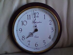 BUCKINGHAM QUARTZ WALL CLOCK, USED,MADE IN ENGLAND,WOOD SURROUND.