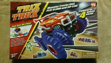 TRIX TRUX - AS SEEN ON TV - FLIPS CLIMES & USE ON ZIP LINE ***NEW IN BOX***