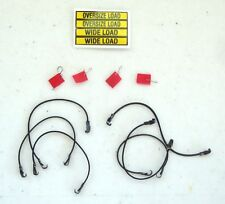 DCP HEAVY HAUL LOADS NEW 4 FLAGS, 6 RUBBER TIE DOWNS. 1 OVERSIZE LOAD DECAL