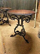 Vintage cast iron ornate base circular table