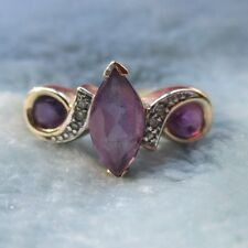 ~ Beautiful 10kt yellow gold ring with Amethyst stones and diamond accents.