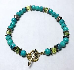 Turquoise Glass Bead Bracelet With Gold Heart And Arrow Toggle Closure