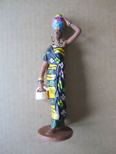 Figurine of African woman carrying a pot on her head