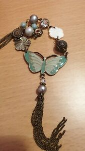 Accessorize Butterfly Pendant Necklace. Duck egg/Green/White/Brown Colours