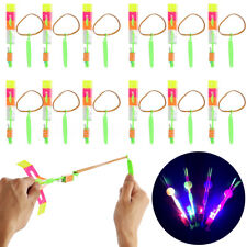 12pcs Funny Flying Rotating Rocket Helicopter Flash LED Light Toy Elastic Cool