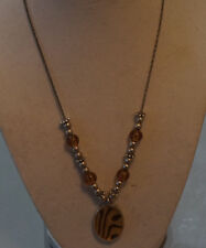 Silver tone necklace, silver and brownish beads, enamel center pendant in center