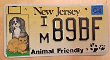 """NEW JERSEY DOG AND CAT LICENSE PLATE  IM 89BF """" NJ DOGS AND CATS ANIMAL FRIENDLY"""