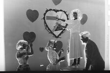 (1) B&W Press Photo Negative Group Decorating Valentines Dance Names Wall T2292