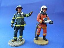 2 figurines de pompier en tenue de feu de New York et Bruxelles - Fireman