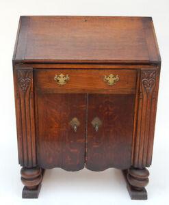 Antique intricately Carved Arts And Crafts  Oak Slant Front Desk circa 1890