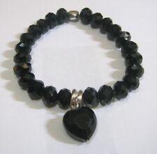 Lovely elasticated black faceted beaded bracelet heart charms