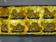 Set of 8 golden dragon statues