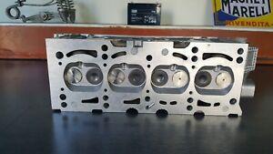 7712265 Testata Fiat-Lancia Panda 4x4 Fiat UNO Motori Fire 8V con cammes Header