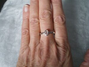 White Topaz Oval ring, size R/S, 0.47 carats, 1.86 grams of 925 Sterling Silver