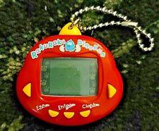 Original RakuRaku DinoKun Dinkie Dino Electronic Virtual Pet TK-910 (Red)