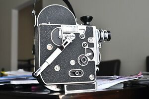 Bolex H16M camera body with a lens