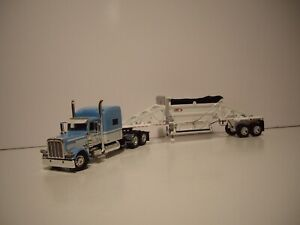 DCP FIRST GEAR 1/64 BLUE AND WHITE PETE 389 WITH SLEEPER AND CPS MANAC TRAILER
