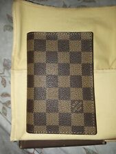 Authentic Louis Vuitton Damier Ebene Canvas wallet. Brown, checkered pattern