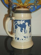 METTLACH EARTHENWARE #2182 RELIEF MOLDED BOWLING STEIN WITH INLAID PEWTER LID
