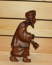 Vintage hand carving wood statuette old man with gas lamp