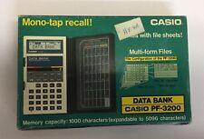NEW Casio PF-3200 LCD pocket Data-Bank computer calculator 1980 NOS RARE Vintage