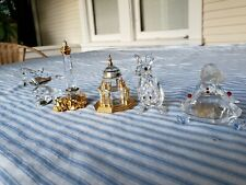 Lot 5 Swarovski Crystal Figurines: Girl, Cathedral, Dolphin, Kangaroo, Lighthous