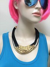 NEW NOIR GOLD TONE+MULTI STRAND BLACK RUBBER CORD STATEMENT NECKLACE