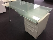 Glass desks with white drawers and chrome legs