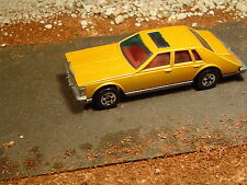 1981 CADILLAC SEVILLE, SUN ROOF, VERY RARE, 1/64 SCALE, GOLD