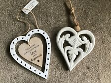 Two wooden decorative sentiment hanging hearts