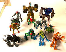 Huge Lot of 12 Vintage 1990?s collectible toys, figurines, transformers